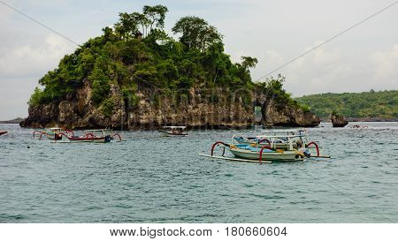 Beautiful view of Crystal Bay with traditional indonesian boats. Nusa Penida Indonesia.