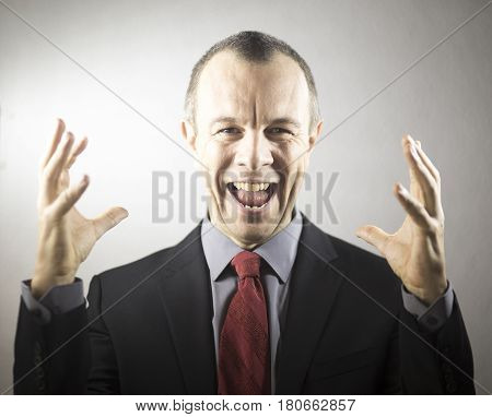 Businessman In Suit Celebrating
