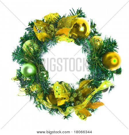 Yellow christmas garland with baubles and ribbons on white.