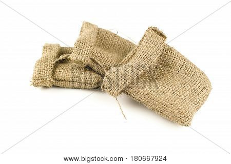Hessian sack tied with string from low perspective isolated against white background