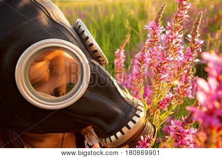 Woman with gas mask and pink flowers