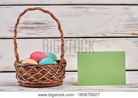 Easter egg basket, blank card. Empty green paper.