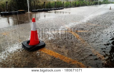 detail traffic cone in raining for background