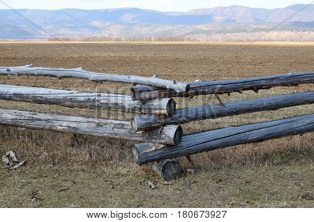 Traditional Zigzag Fence Protecting A Pasture In Buryatia. Tunkinskaya Valley
