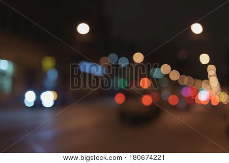 blurred background of night city with car lights, real lens bokeh