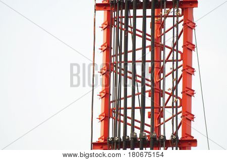 Electrical wires and cables on steel frame.