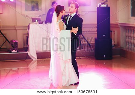 Bride Looks At A Groom With Love Dancing With Him At The First Time