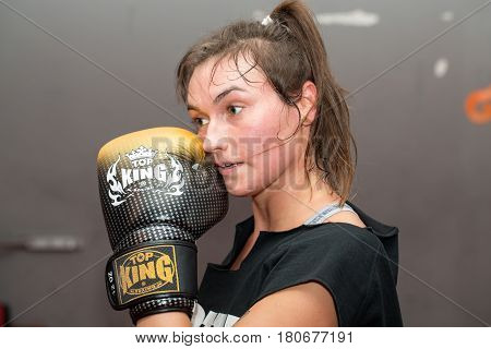 CRACOW POLAND - FEBRUARY 12 2016: Agnieszka Niestoj - talented Polish boxer durning boxing training with coach in the gym. Cracow Poland