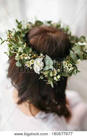 Wedding wreath on the bride's head. Bride's morning
