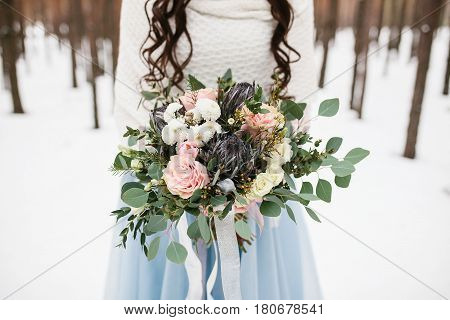 Wedding dress, wedding bouquet. Conceptual image of the bride's morning wedding ceremony.