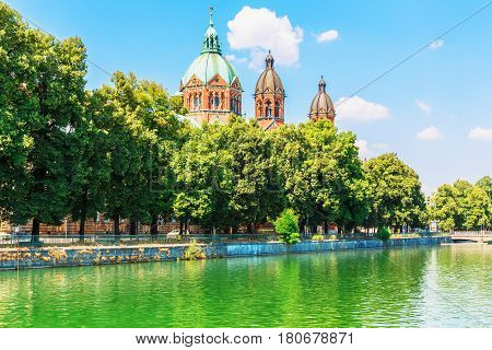 Scenic summer view of Isar river embankment architecture in the Old Town of Munich Bavaria Germany
