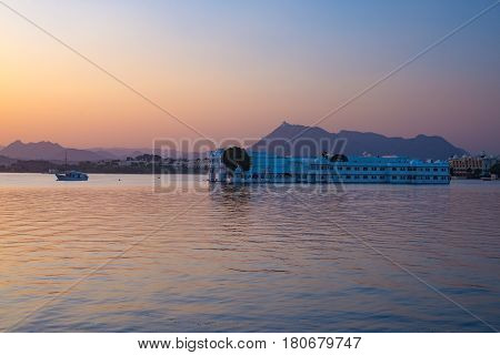 The Famous White Palace Floating On Lake Pichola At Sunset. Udaipur, Travel Destination And Tourist