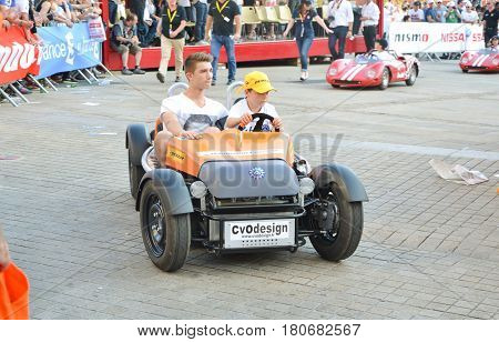 LE MANS FRANCE - JUNE 13 2014: Childrens on sports cars on Parade of pilots racing in Le Mans France