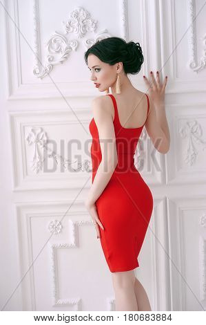 Beautiful sexy woman in a luxurious interior of fashion glamor. Gorgeous brunette girl in hotel. Fashion style fashion woman in fashionable evening dress. Beauty and fashion jewelry model Rich women on retro villas. Vintage