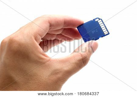 Hand with SD card isolate on white background