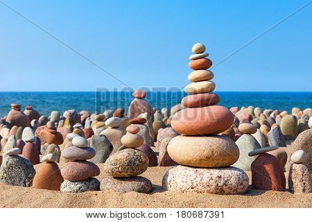 Concept of harmony and balance. double Rock Zen on the background of summer sea