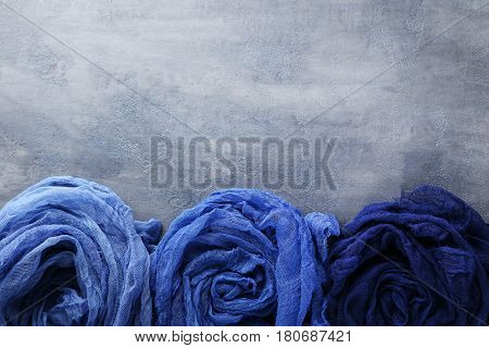 Blue Gauze Fabric On Grey Wooden Table