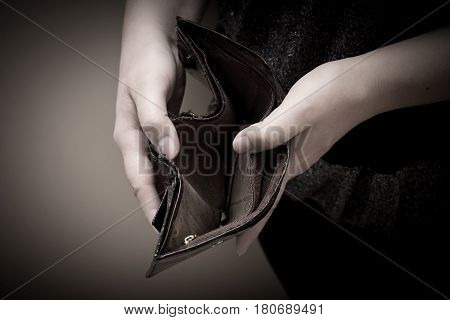 Old Empty Wallet In The Hands Of Women. Poverty Concept.