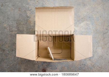 Open cardboard paper box top view, brown box