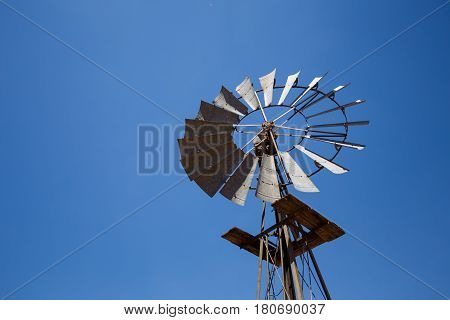 Close Up Wide Angle Image Of A Windmill / Windpomp With Static Blades In The Tankwa Karoo In South A