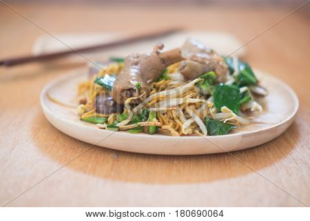 Thai Noodle with chicken on wooden dish