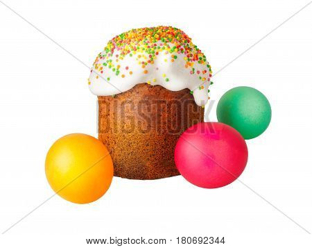 Easter cake with white cap of icing and colored powder, Painted easter eggs isolated on white background. Traditional Slavic festive homemade bread and eggs for the celebration of Orthodox Easter.