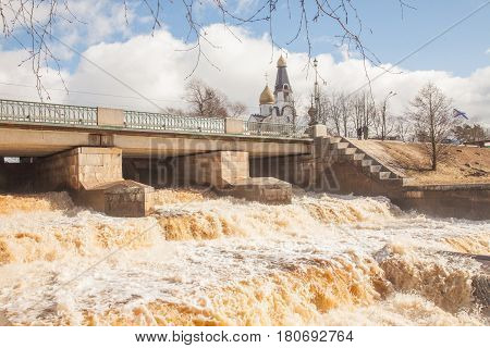 Spring. Full water. Discharge of water from a dam, from prevention of a flood of the river