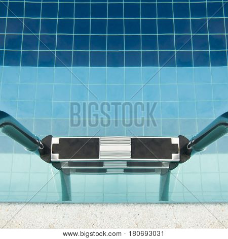 Swimming pool at modern hotel with sunshine