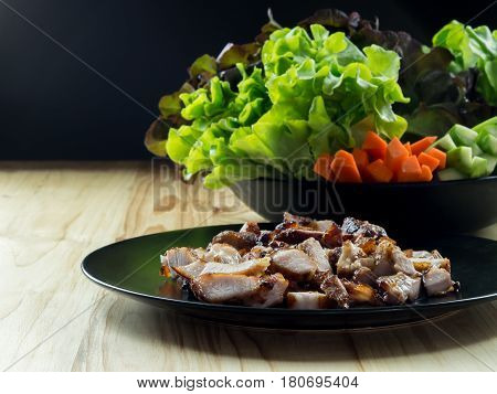 Grilled Pork In A Plate And Green Leafy Vegetables, On Pine Floor.