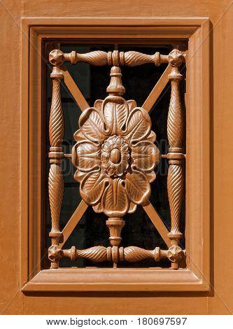 Carved wooden floral pattern decorative door window