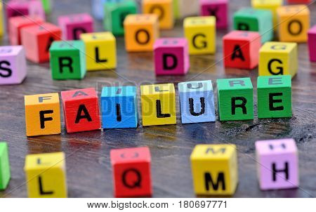 Failure word on wooden table close up