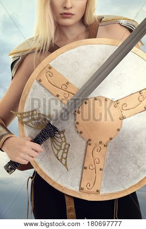 closeup woman warrior with shield and sword