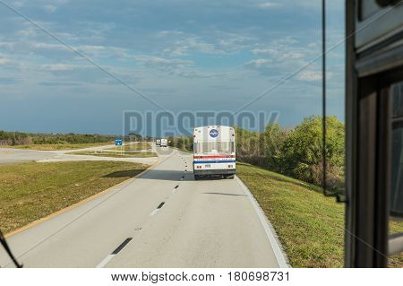 KENNEDY SPACE CENTER FLORIDA USA - FEBRUARY 18 2017: Transport buses transporting visitors to NASA rocket launch FALCON 9