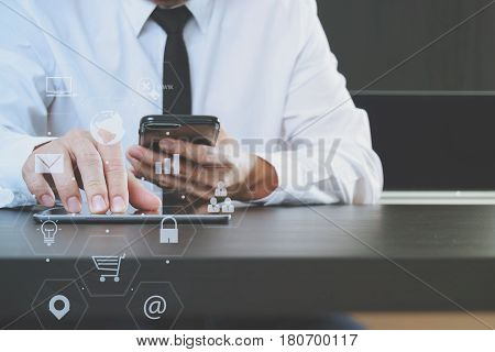 Lawer Working With Smart Phone And Digital Tablet Computer In Modern Office With Virtual Icon Chart