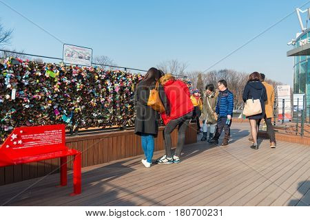 SEOUL - MAR 04,2015 : Love padlocks at N Seoul Tower or Locks of love is a custom in some cultures which symbolize their love will be locked forever at Seoul Tower in seoul,Korea.