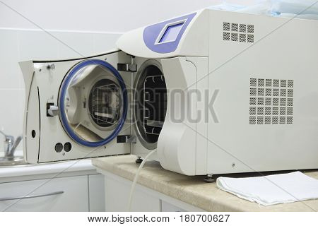Medical sterilizer with open door close up