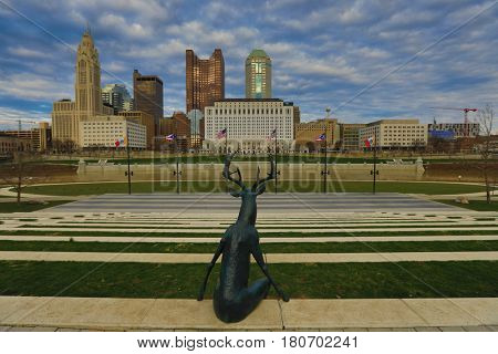 COLUMBUS, OHIO - MARCH 5, 2017:  One of the three deer statues in Columbus, Ohio is perched to enjoy the cityscape.  The statues were created by artist Terry Allen.