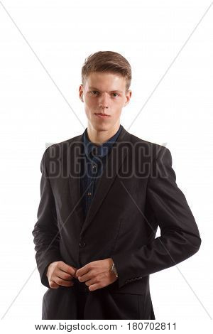 A confident man in a suit on white background