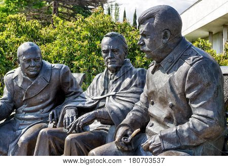 LIVADIA, RUSSIA - MAY 17, 2016: Soviet leader Stalin with Churchill and Roosevelt. Statue by Zurab Tsereteli in the Livadia Palace Crimea Russia. The famous Yalta Conference was held there in 1945.