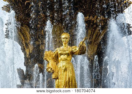 MOSCOW - JULY 29, 2016: The Peoples Friendship Fountain in All-Russia Exhibition Centre (VDNKh). It was built in the 50s. 16 golden sculptures represent republics of the Soviet Union.