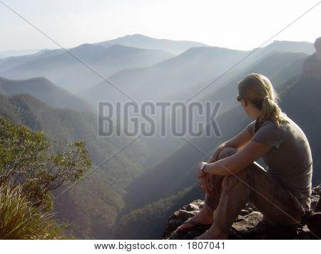 Hiker Overlooking A Valley