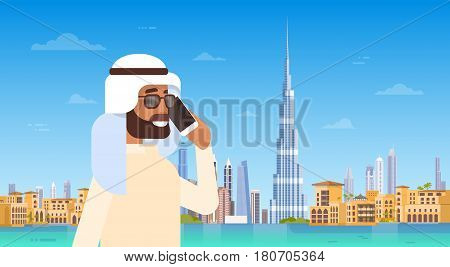Arab Man Speaking On Cell Smart Phone Call Over Dubai Skyline Panorama, Modern Building Cityscape Flat Vector Illustration