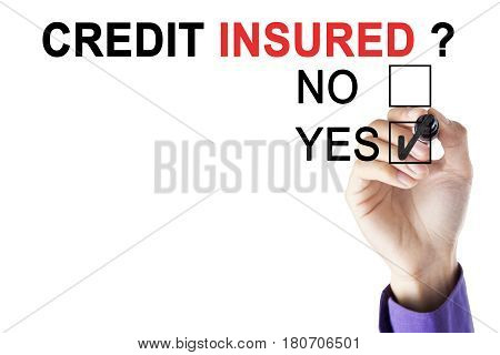 Businessman's hand marking in a yes box with a marker for credit insured isolated on white background