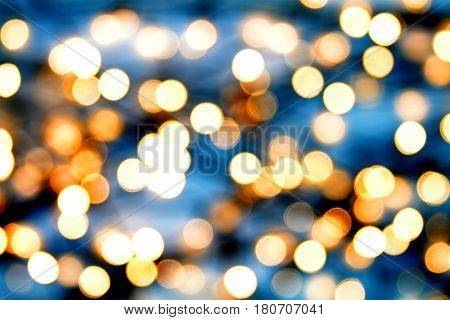 Bright light emitting diodes against dark background, out of focus.