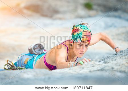Woman in sport climbing in summer time
