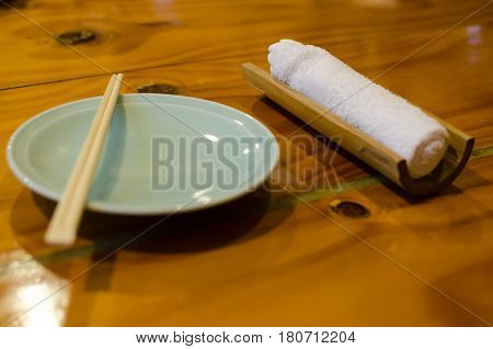 Dish and chop stick and White Mint Towel on Wood in Japan Restaurant