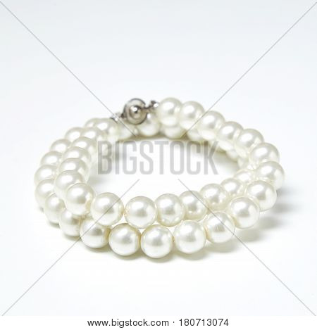 White pearls collier on white background jewelry, cutout