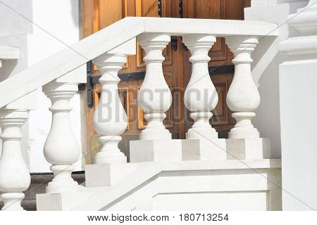 White curved railing of the stairs as interior decoration