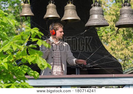 Kiev Ukraine - May 05 2016: Bell-ringer play on the set of bells of Holy Trinity Monastery of St. Jonas