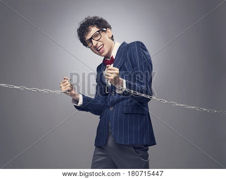 Businessman Breaking Chain